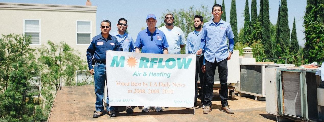 Morflow team holding a sign